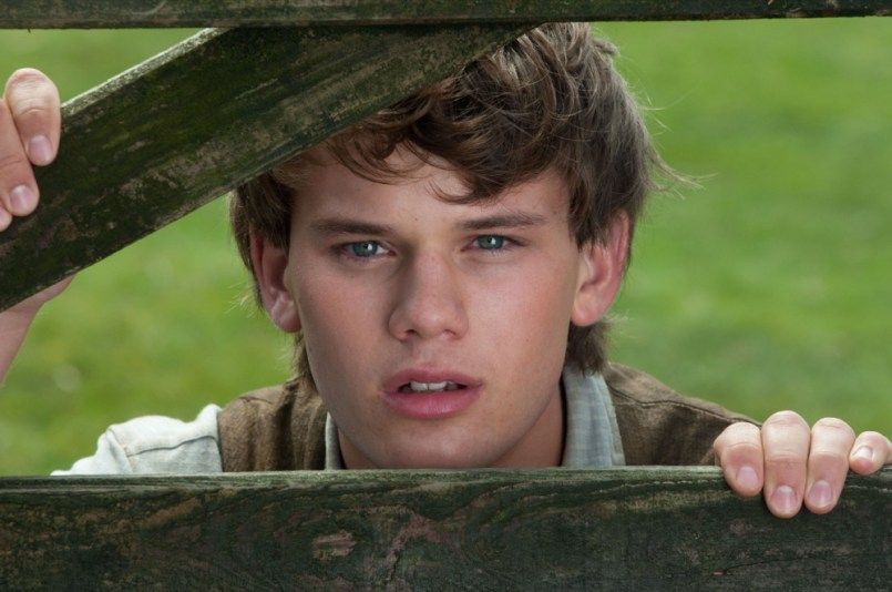 """WAR HORSE""..DM-PSD3-0202..Albert Narracott (Jeremy Irvine) watches his beloved new horse in DreamWorks Pictures' ""War Horse"", director Steven Spielberg's epic adventure and an unforgettable odyssey through courage, friendship, discovery and wonder...Ph: David Appleby..©DreamWorks II Distribution Co., LLC. ÊAll Rights Reserved."