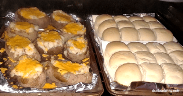 Twice baked potatoes and dinner rolls in the oven
