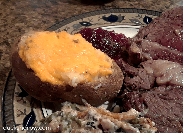 Cheddar cheese topped twice baked potatoes