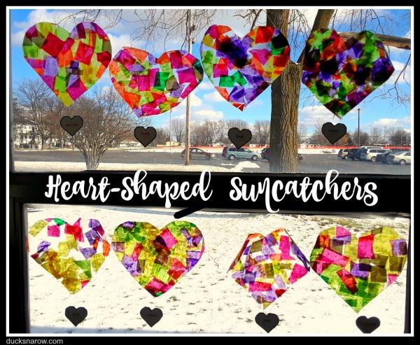 Display of heart shaped suncatchers made by preschoolers #kidscrafts