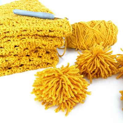 crocheted yellow blanket