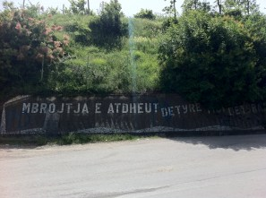 """burrel. """"Defense of the fatherland is the duty above all duties."""" this was a well known communist saying. This is now completely painted over."""