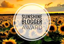 """A field of sunflowers with the words """"Sunshine Blogger Award"""" written in text"""