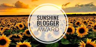 "A field of sunflowers with the words ""Sunshine Blogger Award"" written in text"