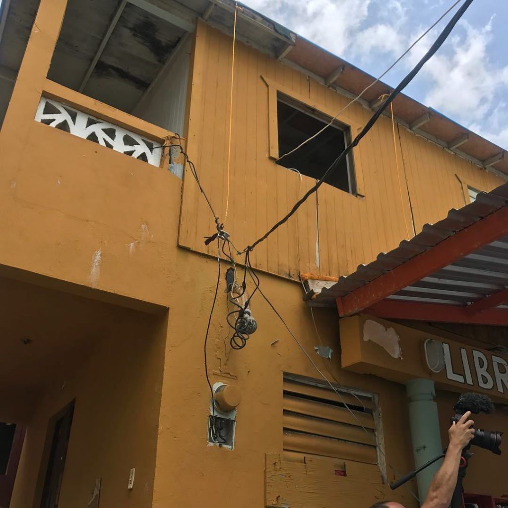 hight resolution of exterior of building with exposed electrical wiring
