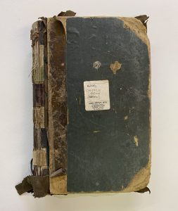 Book before repairs to the spine and corners