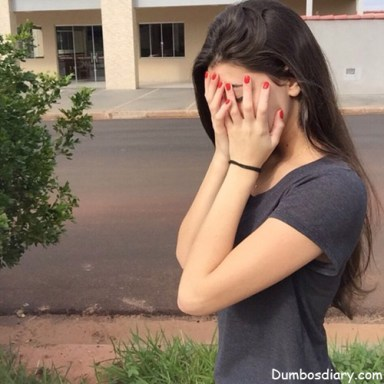 Beautiful girl hiding her face