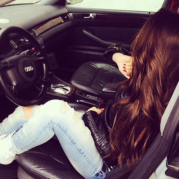 Beautiful girl relaxing in car