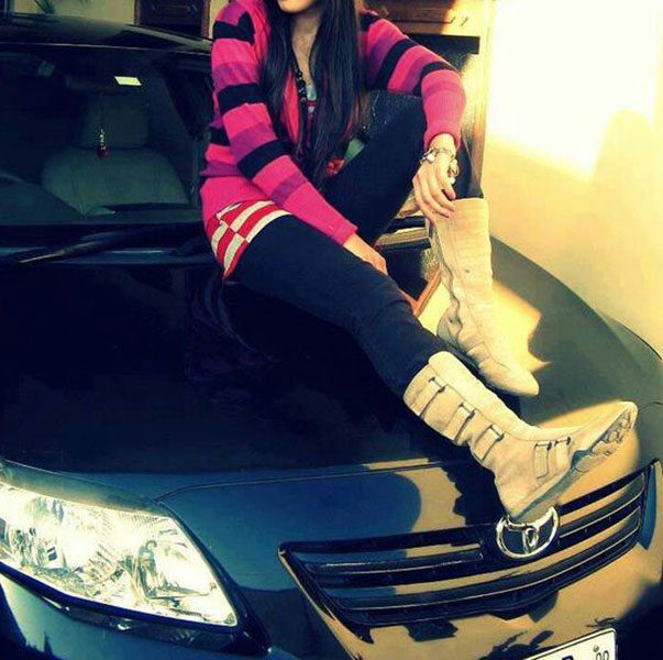 Fashion and stylish girl sitting on car