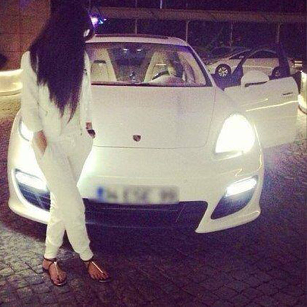 Girl on parking with car