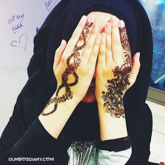 Henna hands cute hijabi girl hidden face