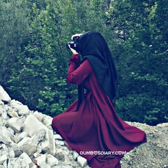 Hidden face muslim girl capturing the greenry