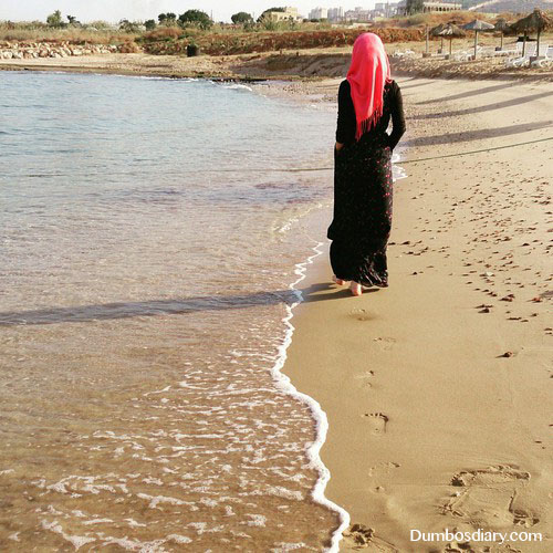 Muslim girl on beach