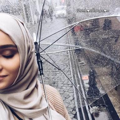 Pretty Hijabi girl with umbrella