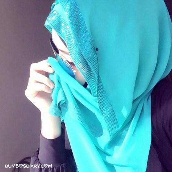 Pretty girl in hijab wearing sunglass