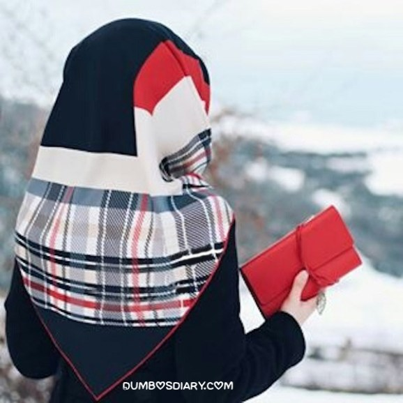 Pretty hijabi girl holding red pouch