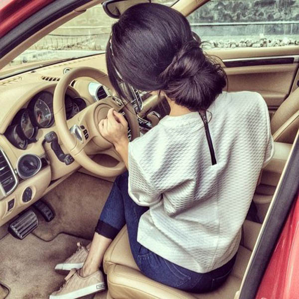 Thinking girl in car