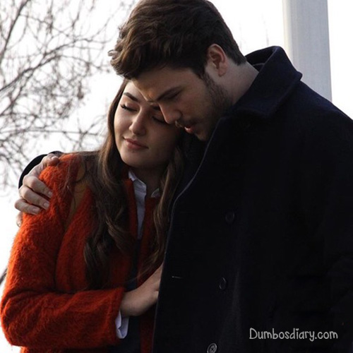 couple-walking-while-hugging