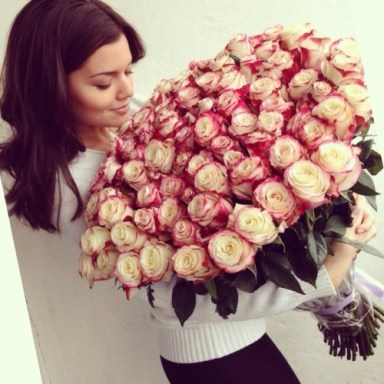 cute-girl-with-big-bouquet-of-roses
