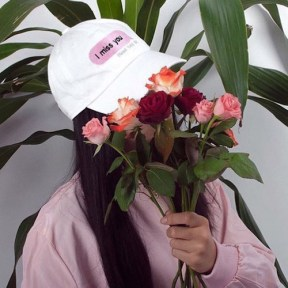 girl-hidding-her-face-with-roses
