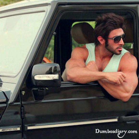 Boy with muscular body in car window