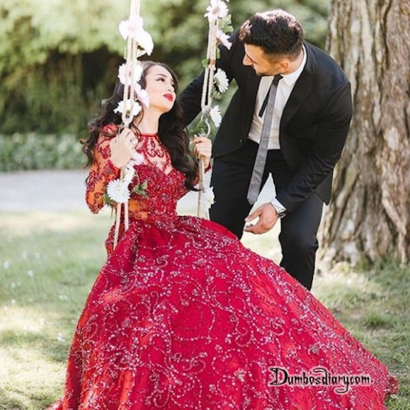Couple in garden bride swinging