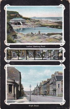 """Figure 6: The postcard links the lido / ladies' pool to the High Street Post Office. The sender writes from Ninewar, Prestonkirk on 17/3/1912. The card is posted the same day but from Prestonkirk Post Office. to A J Large Esq., 51 Albert Road, Dalston, London NE1. """"Dear Chum, Your card of 5/3/12 to hand with thanks also for photo. Glad my card was the cause of a table topic. In this view you can see the PO to the left where I said it was windy. I have indic. by arrows the direct. of wind which comes in at the side. You can see the spire of the Town Hall and at the end of the street the much talked of barracks of Dunbar, which have been a case for Lord Haldane. I will try and get you one of it by next time. In the upper view the Bass Rock appears to the right of the horizon. How are you getting on with the coal strike? Yrs sinc. W. Curr"""" William S Curr was the factor for Mrs. N. Hamilton-Ogilvy, Ninewar, Dunbar, according to Slater's 1903 directory."""