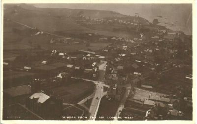 Figure 7: An undated aerial view on a postcard, before remodelling and before the erection of what became Hughes Garage.