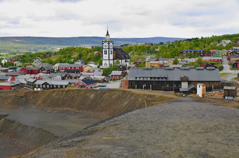 Copper Ore Slag Heap with Church in background, Roros, Trondelag County, Norway. - ...behind every picture, there is a story...