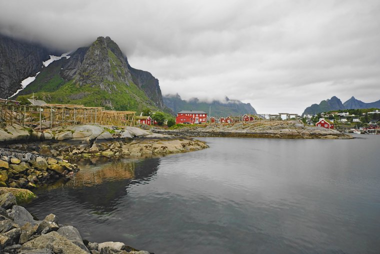 Reine, Moskenesøya Island, Lofoten Archipelago, Norway Fish stock racks for curing fish - ...behind every picture, there is a story...