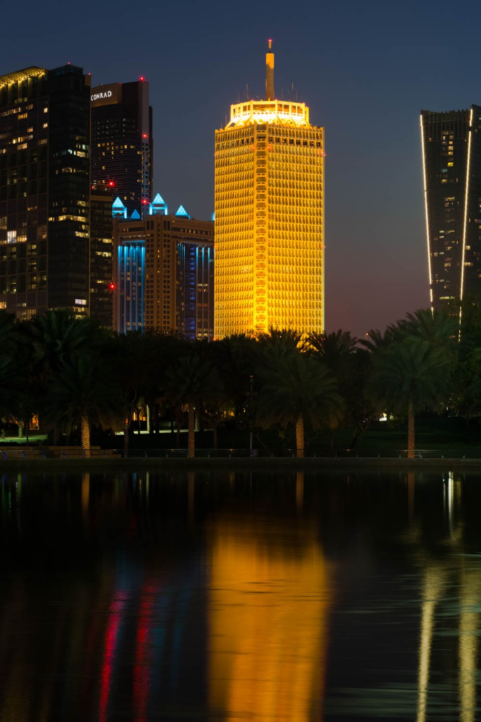A night time architectural photograph of the World Trade Centre, Dubai by photographer, Duncan Chard
