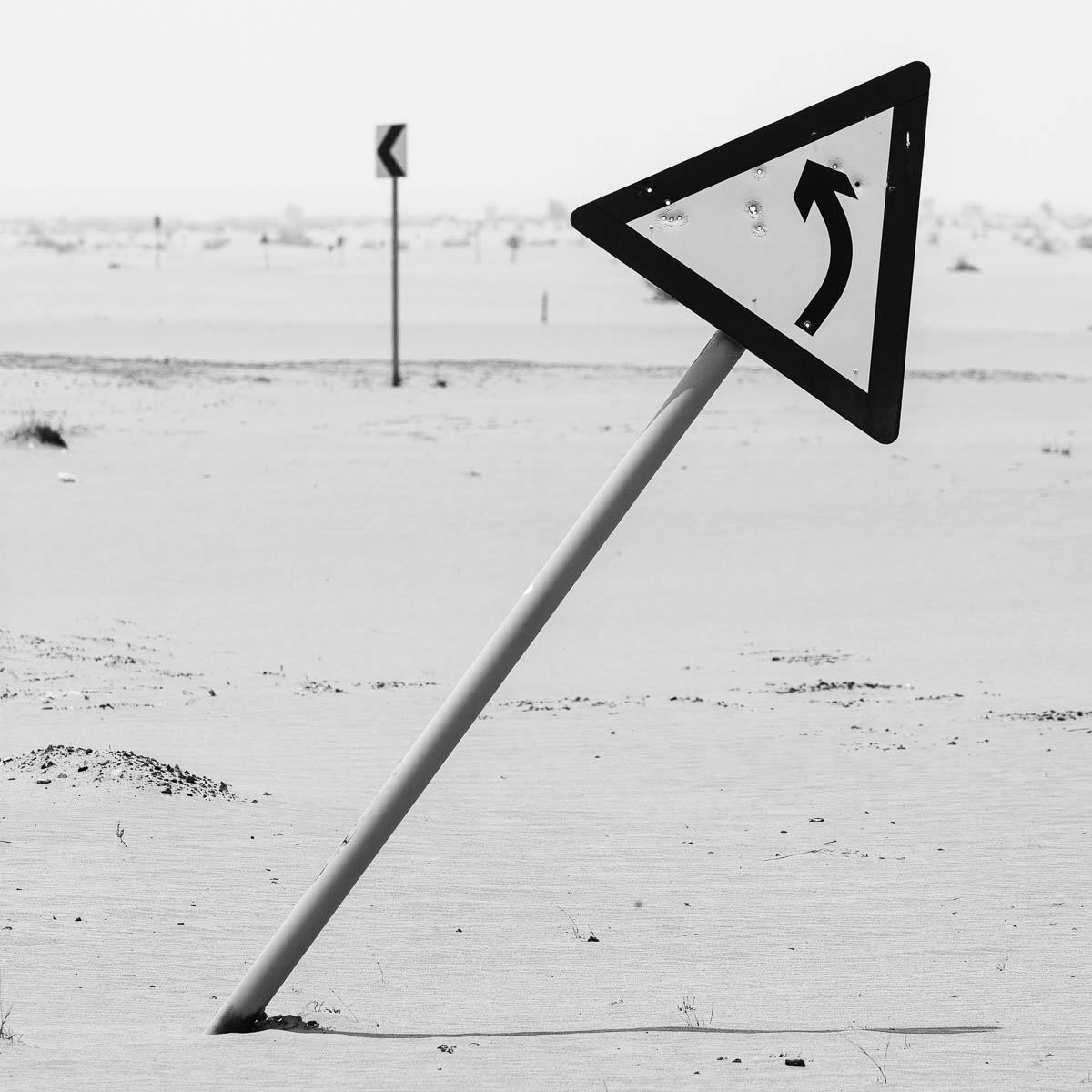 A road sign in the desert used as target practice, Dubai, UAE