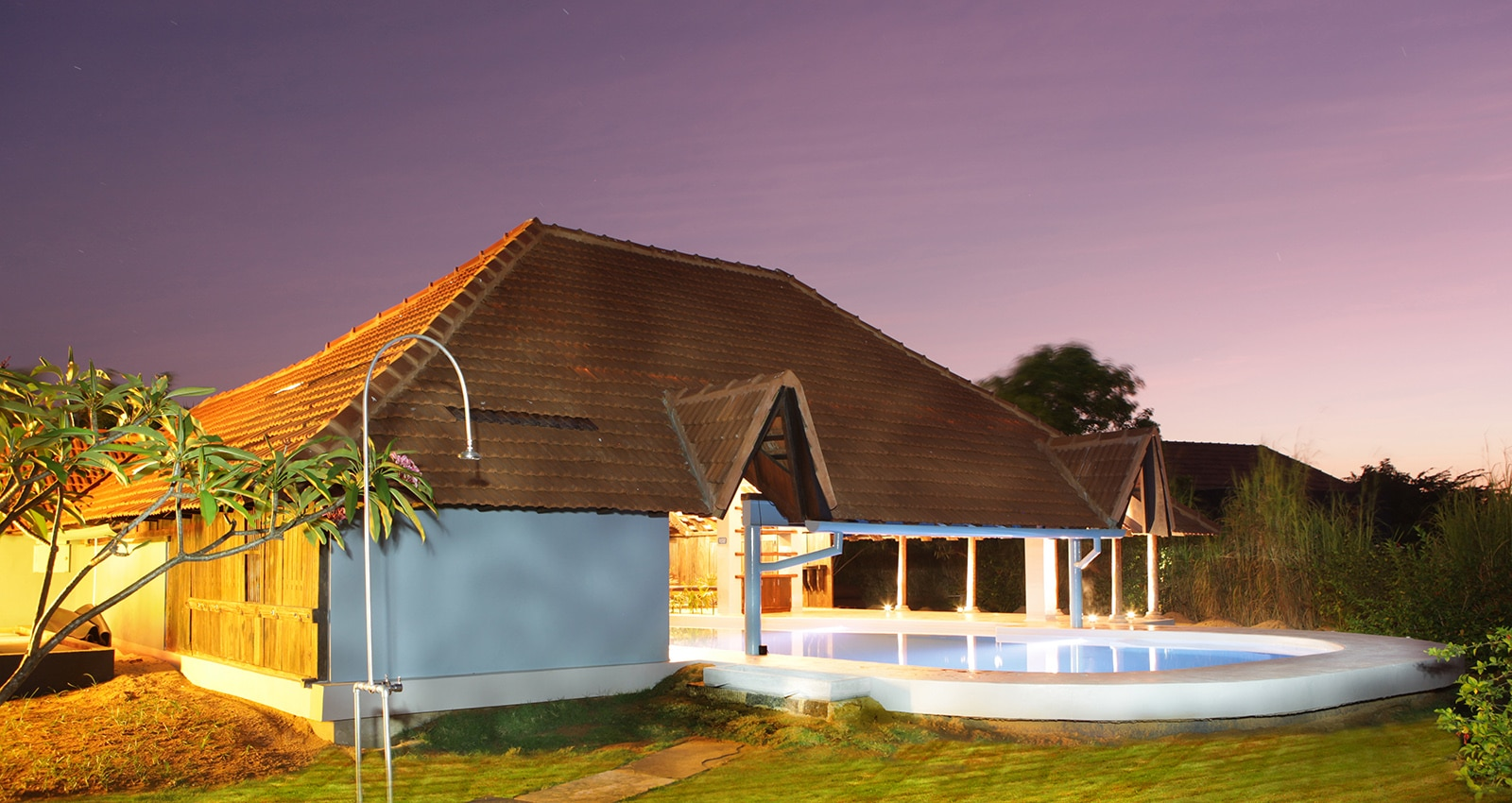 Night view of magic water swimming pool in Dune Eco Village
