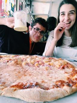 Here's an iconic picture of a dynamic duo: Daniel Saiz and Maile Wobb hard at work, or ya know, just making the pizza a bit cheesier.