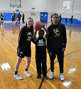 Central players bring annual Christmas cheer, give out basketballs