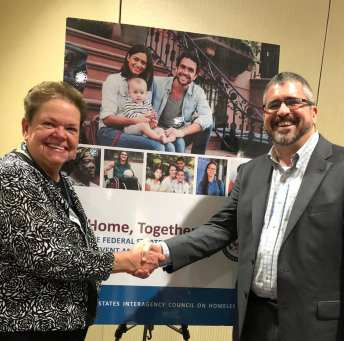 Carol Simler with Matthew Doherty, Executive Director of U.S. Interagency Council on Homelessness.