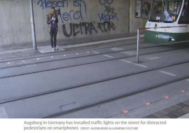 Street-embedded lighting assists texters