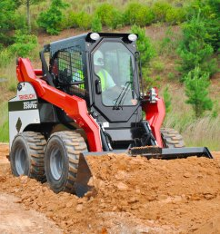 takeuchi ts80v2 skid steer loader pushing dirt [ 1200 x 803 Pixel ]