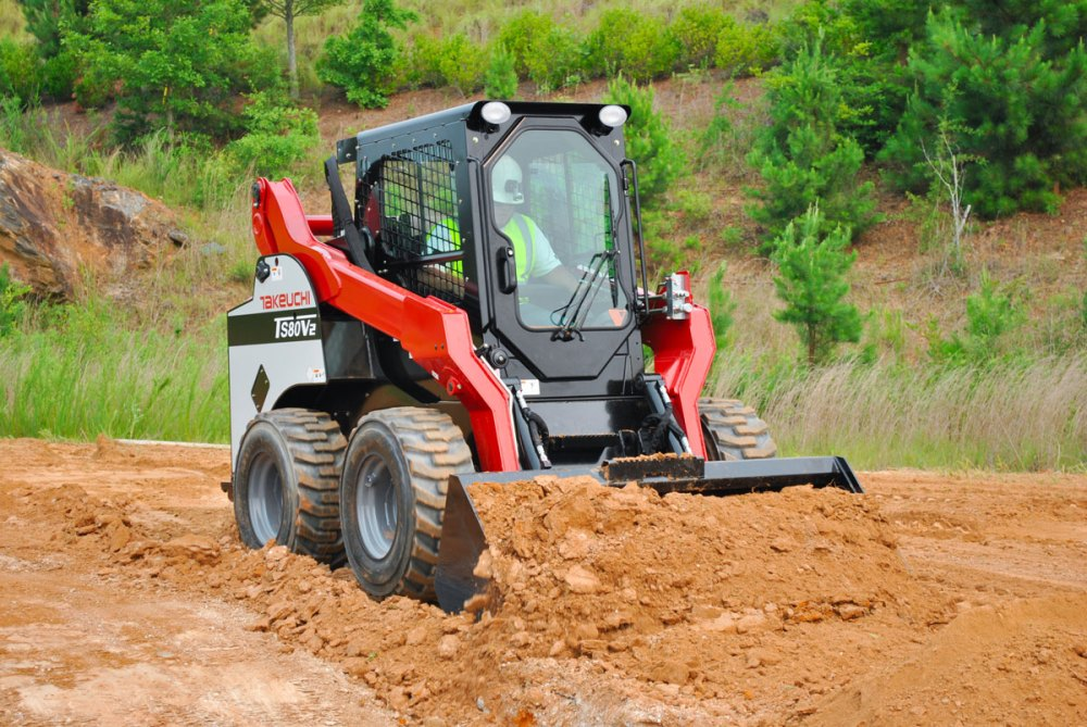 medium resolution of takeuchi ts80v2 skid steer loader pushing dirt