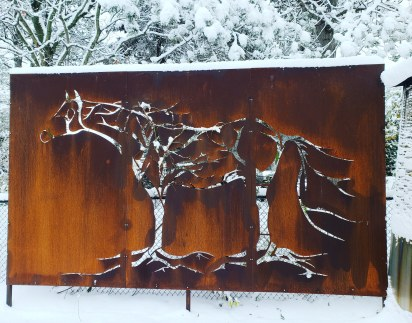 Corten steel rust patina privacy screen. An extremely large metal canvas provided privacy from the adjacent property. This Horse in Trees measures 14ft wide by 7ft height and is installed on concrete. Hamilton, Ontario