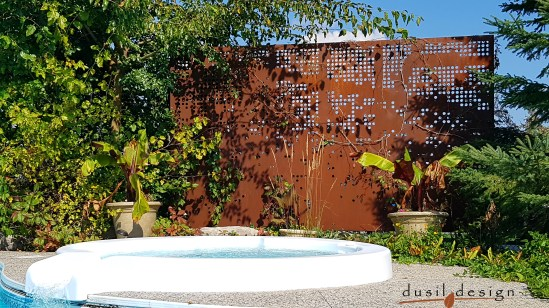 A beautiful Digital cutout on this privacy screen shows plenty of privacy around a hot tub and keeps neighboring properties from seeing inside. Corten steel Digital pattern in Flamborough, Ontario