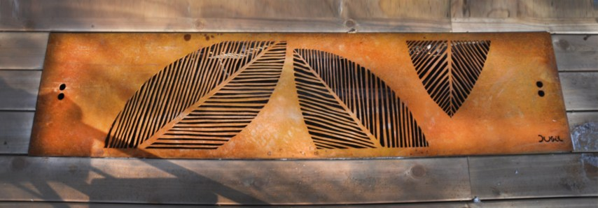 Cor-ten steel deck inset adds interest and light to a basement window enhances an otherwise plain cedar deck. Oakville, Ontario
