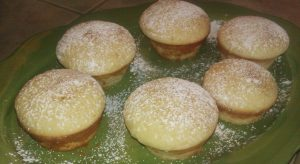 Orange cupcakes sprinkled with powdered sugar and cinnamon.