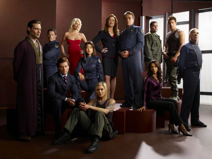 "BATTLESTAR GALACTICA -- Pictured: (l-r) James Callis as Gaius Baltar, Tahmoh Penikett as Karl ""Helo"" Agathon, Jamie Bamber as Lee ""Apollo"" Adama, Tricia Helfer as Number Six, Grace Park as Sharon Valerii, Katee Sackhoff as Kara ""Starbuck"" Thrace, Mary McDonnell as Laura Roslin, Edward James Olmos as William Adama, Aaron Douglas as Tyrol, Reka Sharma as Tory Foster, Michael Trucco as Sam Anders, Michael Hogan as Saul Tigh -- SCI FI Channel Photo: Art Streiber"