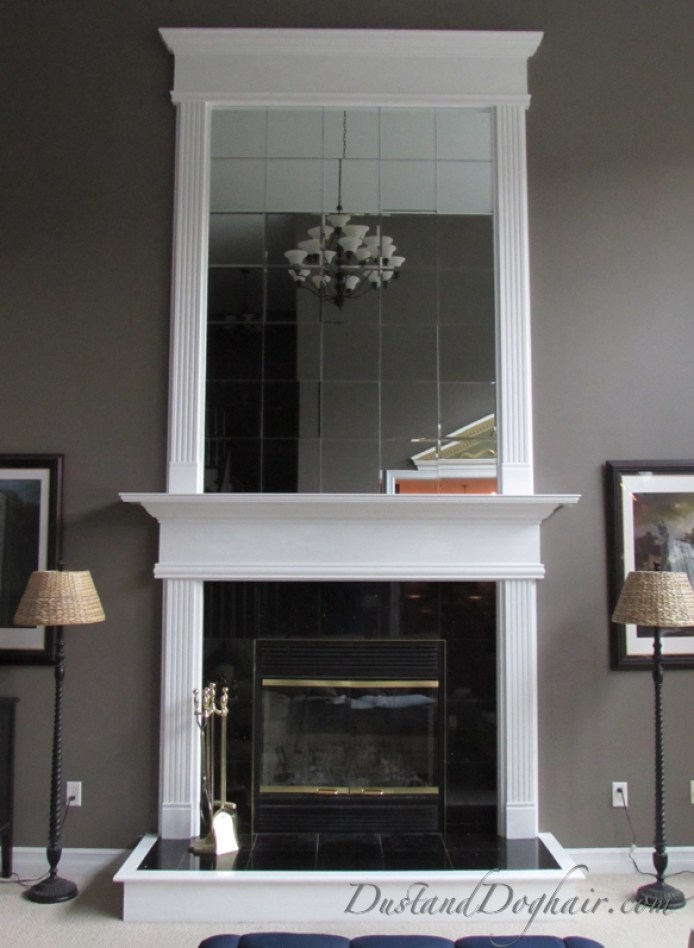 fireplace mirror options greige walls overmantel wood trim crown molding