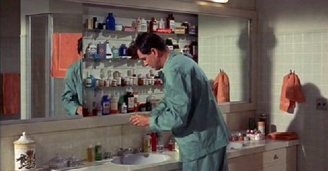 George at the medicine cabinet