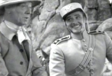 Vickers helps escort Harcourt to Suristan