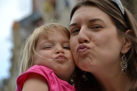 "In front of La Sagrada Familia (her new ""cheese face"")"