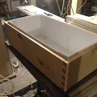 Wooden aquaponics/hydroponics grow bed with coroplast liner.