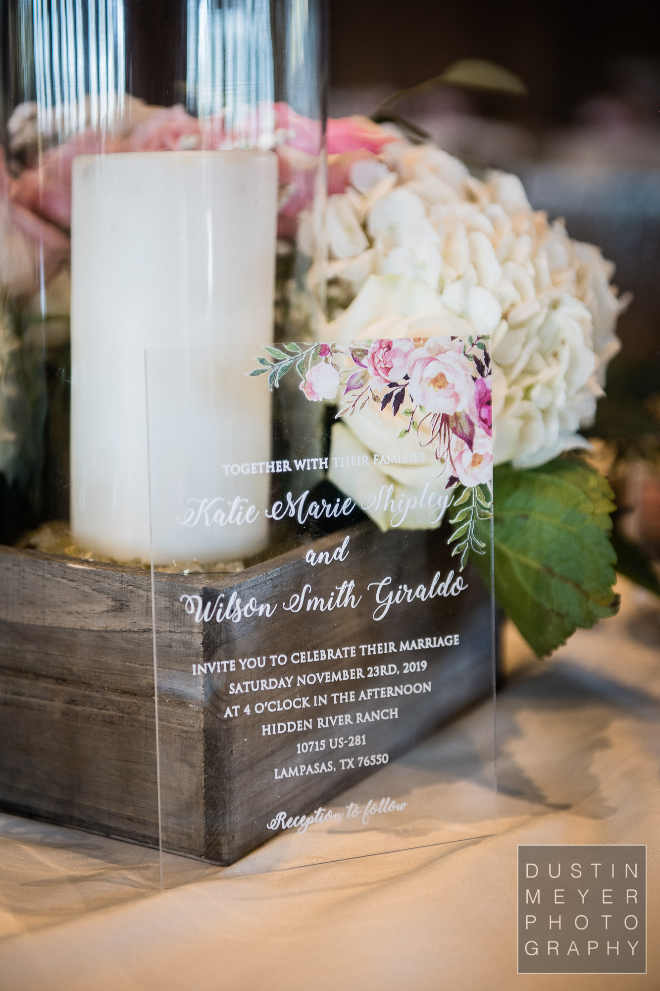 A unique personalized wedding invitation with wedding flowers